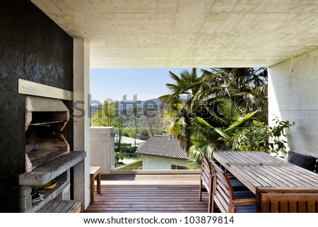 beautiful modern house, veranda with fireplace - stock photo