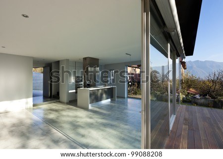 beautiful modern house, view of kitchen from the patio - stock photo