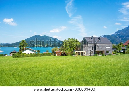 beautiful modern house with garden at the lake, outdoor - stock photo