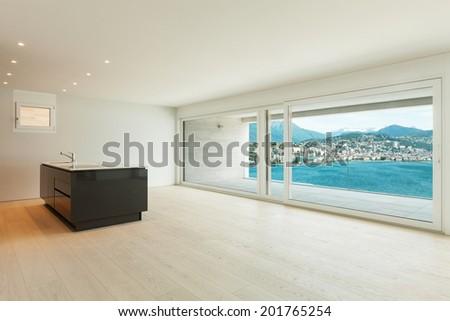 beautiful modern kitchen with window overlooking the lake  - stock photo