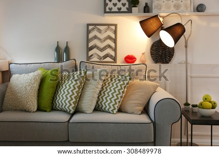Beautiful modern living room with grey sofa and floor lamp - stock photo