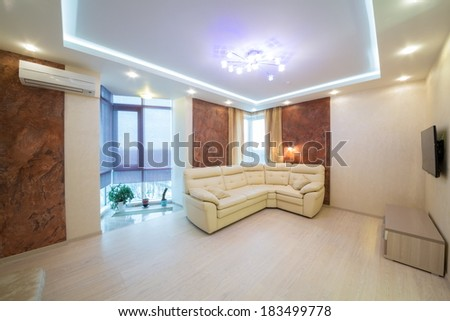 Beautiful modern living room with sofa, TV and conditioner. - stock photo