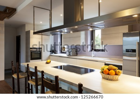 Beautiful modern loft, view of the kitchen - stock photo