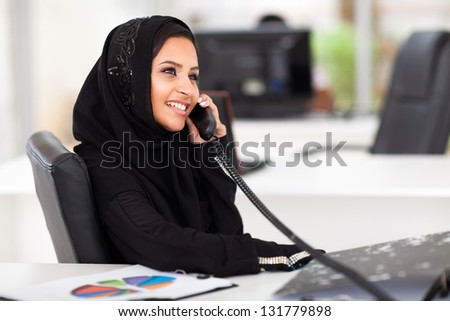 beautiful modern middle eastern office worker talking on the phone - stock photo