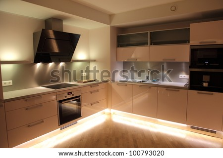 Beautiful modern nordic kitchen with modern lighting - stock photo