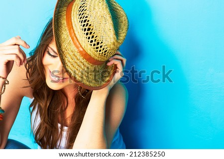 Beautiful modern style woman looking down . face portrait . yellow hat . - stock photo