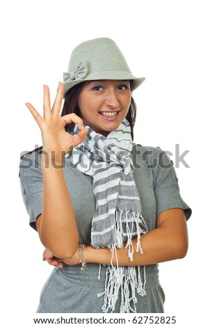 Beautiful modern woman in hat showing okay sign isolated on white background