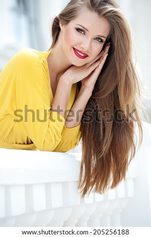 Beautiful modern woman with long hair. Smiling girl