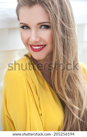 Beautiful modern woman with long hair. Smiling girl  - stock photo