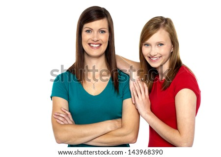 Beautiful mom and daughter posing confidently - stock photo