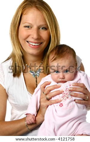 Beautiful mom with newborn baby girl in pink suit.