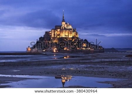 Beautiful Mont Saint Michel in France seen at dusk - stock photo