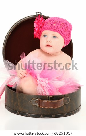 Beautiful 4 month old american baby girl sitting in travel case over white background. - stock photo