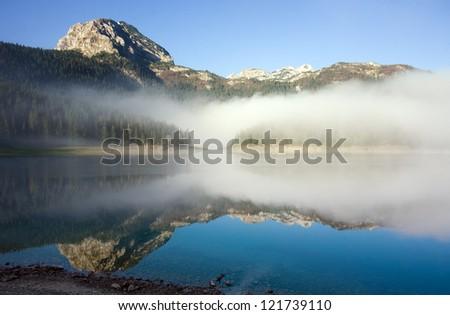 Beautiful morning on the mountain lake - stock photo