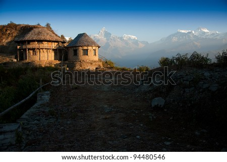 Beautiful morning view of the classic house near Himalayan mountains when see from Sarangkot, Pokhara, Nepal - stock photo