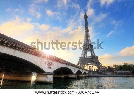 Beautiful morning view of the Eiffel tower and bridge at the Seine in spring in Paris, France - stock photo