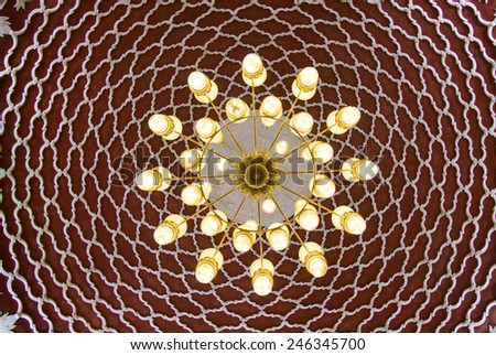Beautiful mosaic design on ceiling . Ornaments on the walls and chandelier composition - stock photo