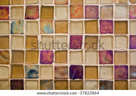 beautiful mosaic glass tile background, gold and red tones - stock photo