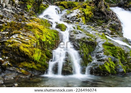 Beautiful moss covered Sarrail Creek Falls in the summer on the Kananaskis Lake Hiking trail, Alberta Canada - stock photo