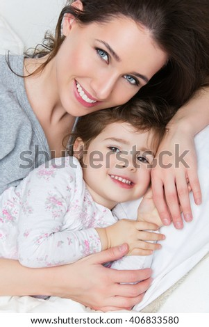 Beautiful mother and child - stock photo