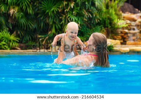 Beautiful mother and child in the open air. Nature. Outdoor portrait of a happy family. The joy. The baby and mother in the tropics.