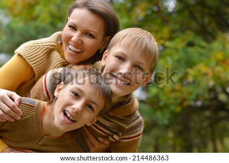 Beautiful mother and children over natural background