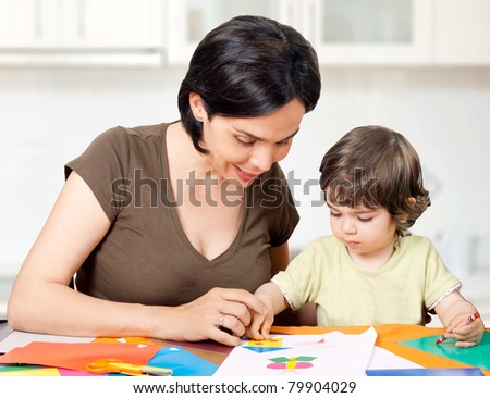 Beautiful mother and daughter making a drawing