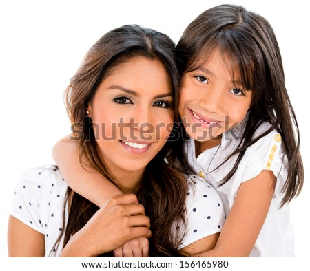 Beautiful mother and daughter smiling - isolated over a white background  - stock photo