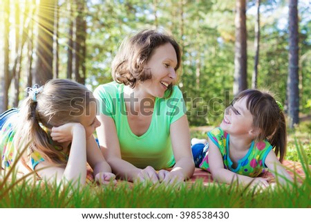 Beautiful mother and her daughters. - stock photo