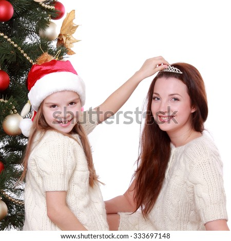 beautiful mother and little girl having fun time on Christmas