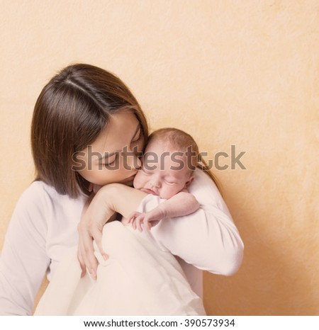 beautiful mother holding baby - stock photo