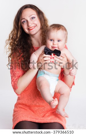 Beautiful mother with baby boy in studio