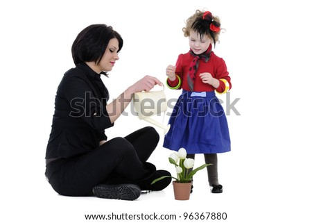 beautiful mother with her daughter studio shoot - stock photo
