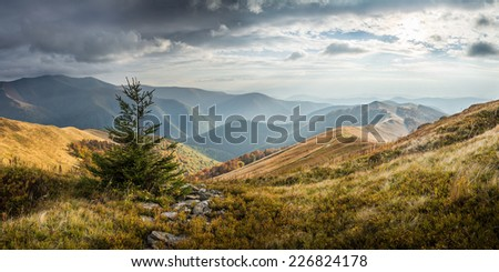 Beautiful mountain autumn landscape with clouds - stock photo
