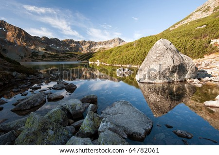 beautiful mountain lake with reflection in High Tatras - stock photo