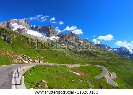 Beautiful mountain landscape, alpine road through Furka Pass, Switzerland - stock photo