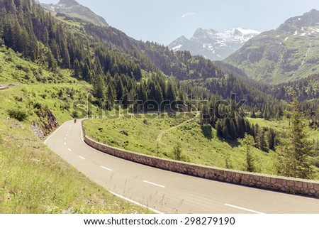 Beautiful mountain landscape, alpine road through pass, Switzerland - stock photo