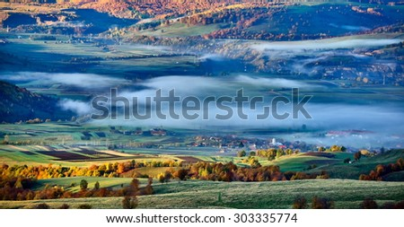 beautiful mountain landscape in foggy morning - stock photo