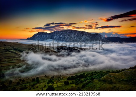 beautiful mountain landscape in foggy morning in Alba, Romania - stock photo