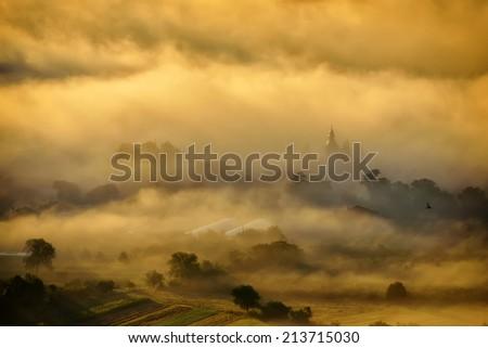 beautiful mountain landscape in foggy morning in Alba, Romania - stock photo