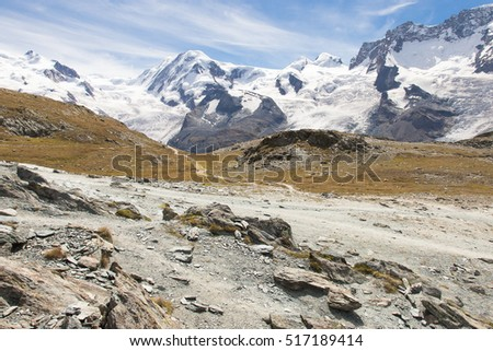 beautiful mountain landscape in sunny summer day with the blue sky. Switzerland, Zermatt, the mountain covered with snow