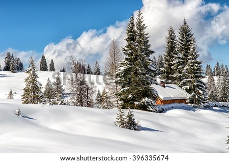 Beautiful mountain landscape in the Austrian Alps with traditional mountain lodge.