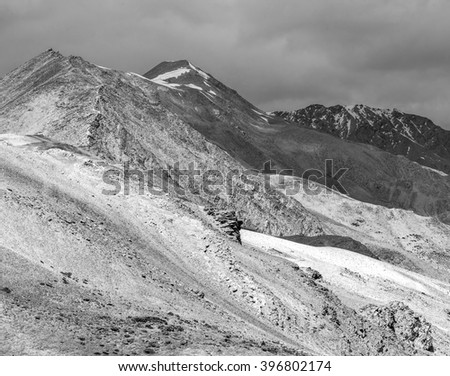 Beautiful mountain landscape near the Tso Moriri lake and Karzok village in Rupshu valley against the background of cloudly sky - Tibet, Ladakh, Himalayas, Jammu and Kashmir, India (black and white) - stock photo