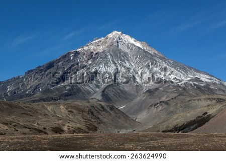 Beautiful mountain landscape: view on active Koryaksky Volcano (Koryak Volcano) on the Kamchatka Peninsula. Russia, Far East. - stock photo