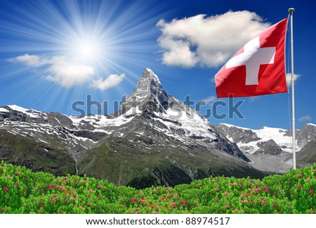 Beautiful mountain Matterhorn with Swiss flag - Swiss Alps - stock photo