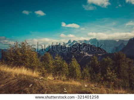 Beautiful mountain panorama in Julian Alps in Slovenia. This is a typical postcard from Slemenova spica with the mighty Jalovec in the backround.