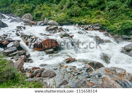 Beautiful mountain river on the way to the Vally of flowers national park high in the Himalayas, India - stock photo