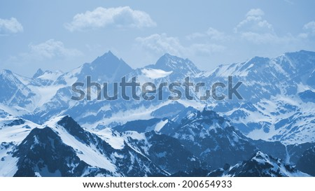 beautiful mountain scenery and many snow-capped summit
