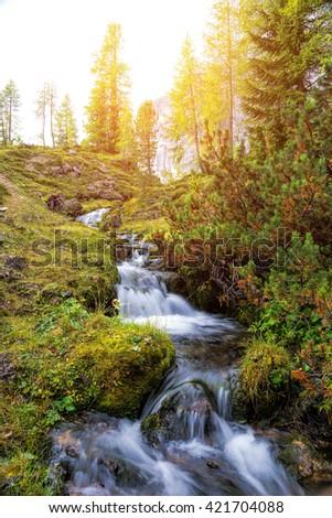 Beautiful mountain stream in the Dolomites - stock photo