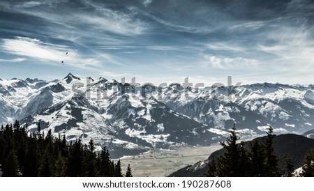 Beautiful mountain view with paraglider (Kitzsteinhorn ski resort view) - stock photo